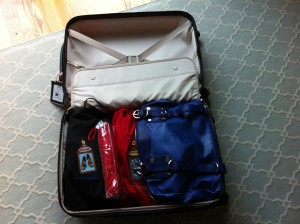 how to fold clothes for packing a suitcase
